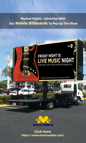 A Classic & Attractive Mobile Billboard Advertisement Truck Driving Down The Road On Las Vegas Which Is About A Grand Musical Night.